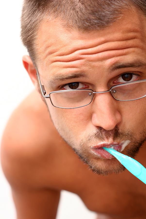 bigstock_Man_and_Toothbrush_768019